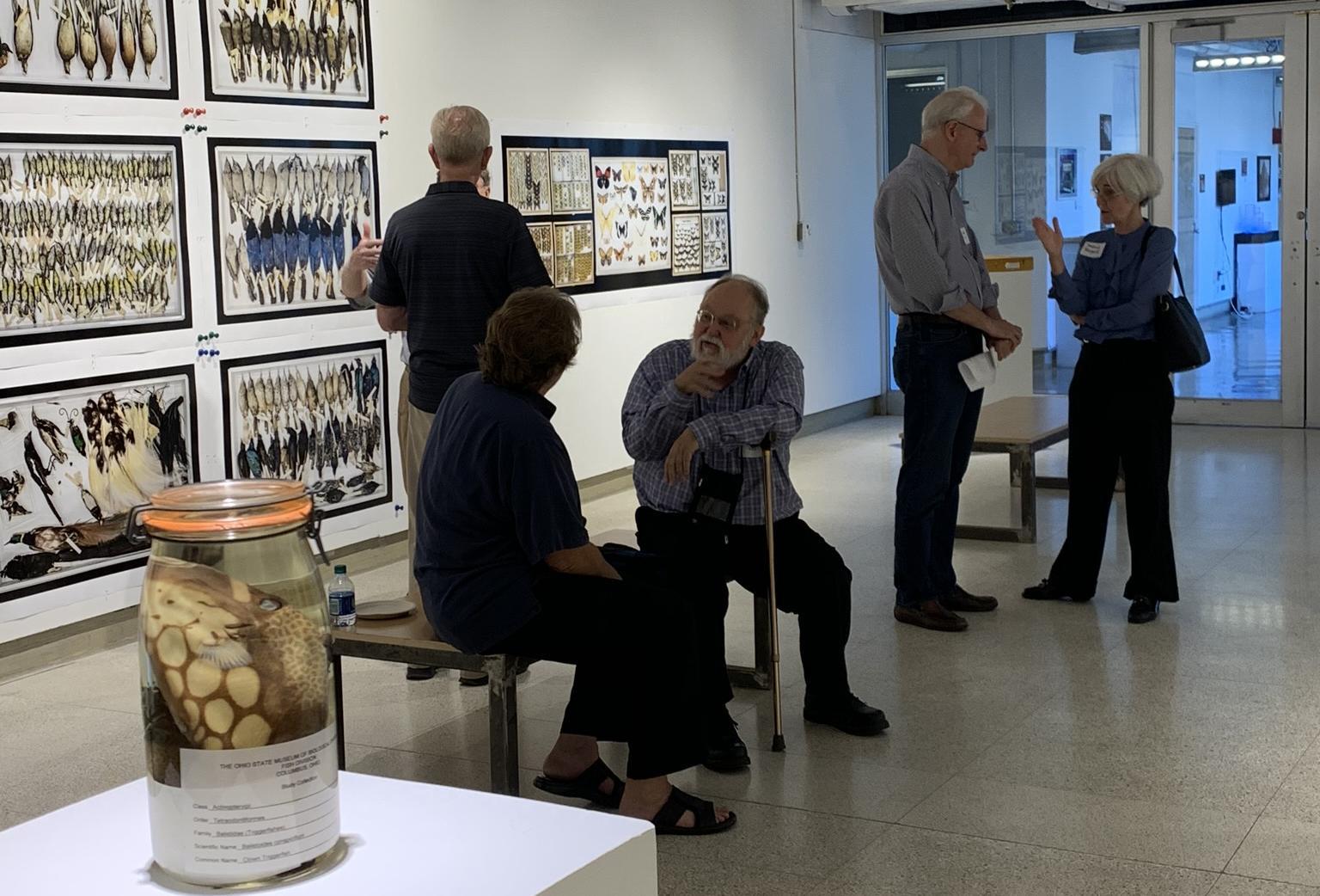 Emeritus faculty conversing.